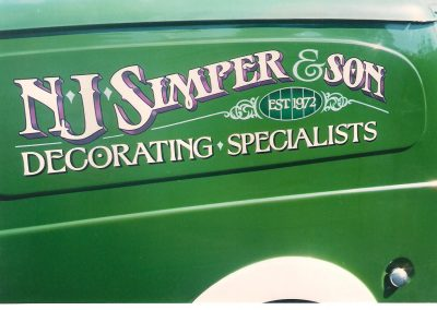 Combination of vinyl and traditional signwriting